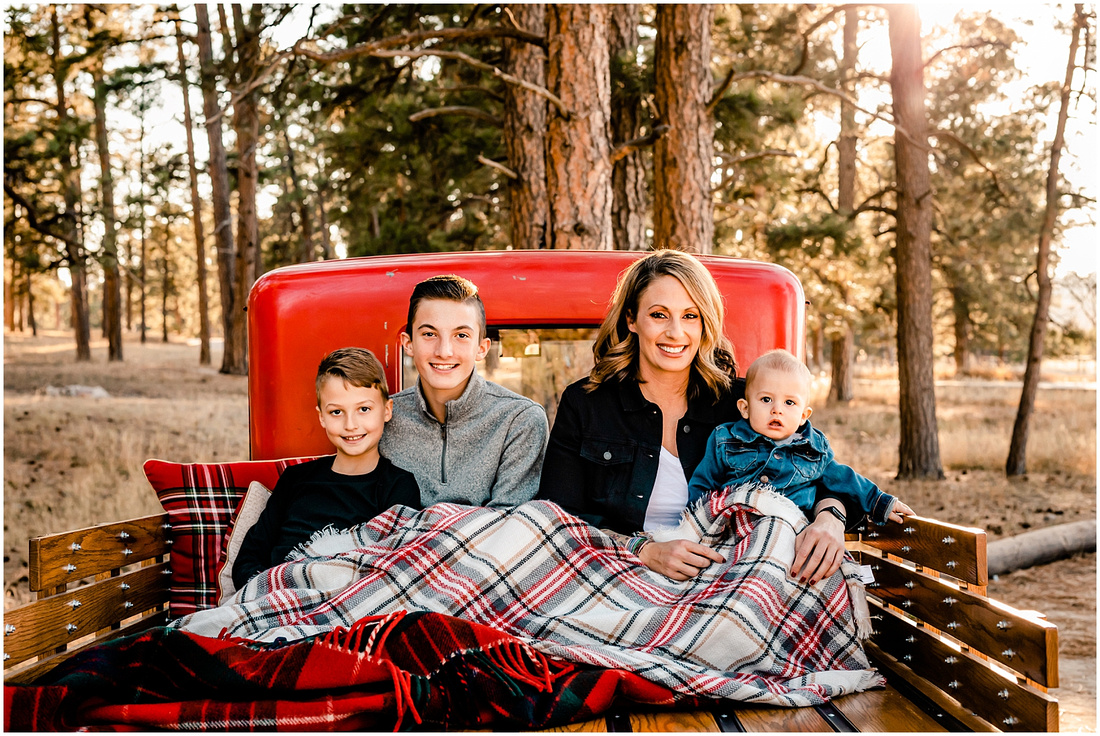 Family of 4 with an antique Ford Model A truck in Colorado