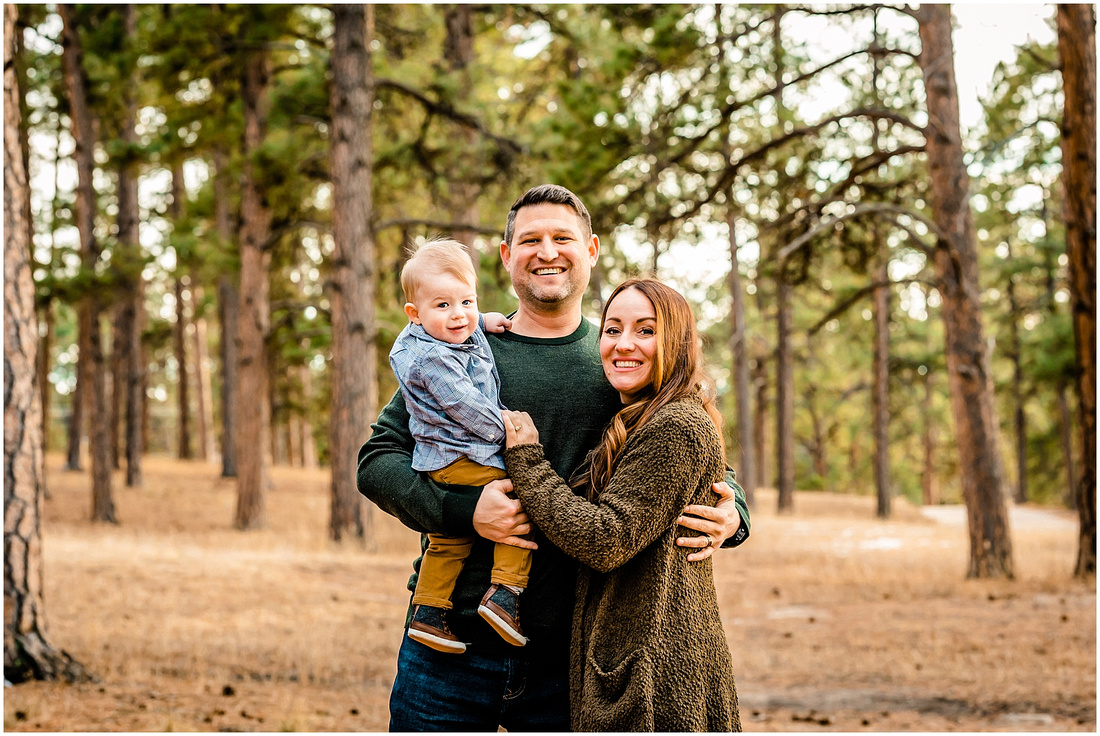 Winter family photos in a Colorado pine tree forest.