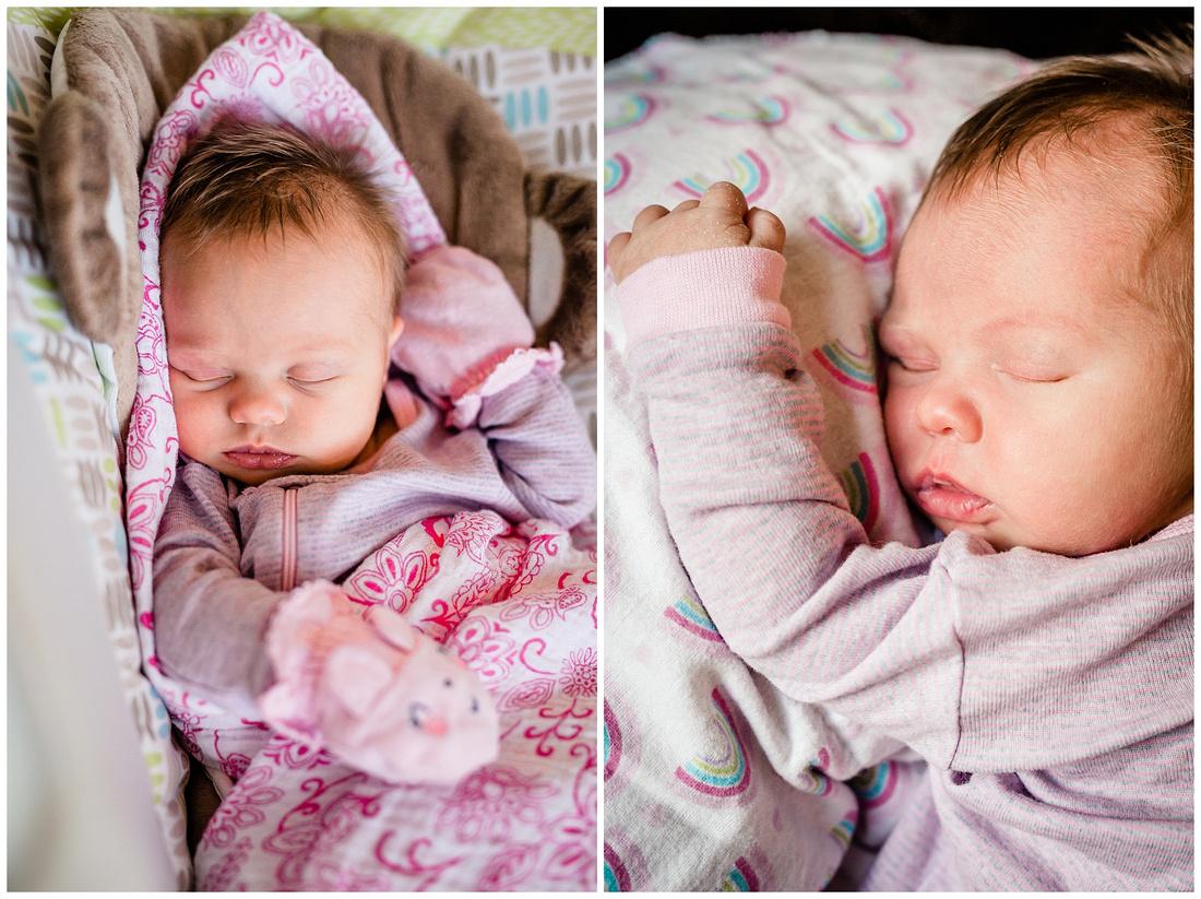 newborn baby girl sleeping in a bouncer