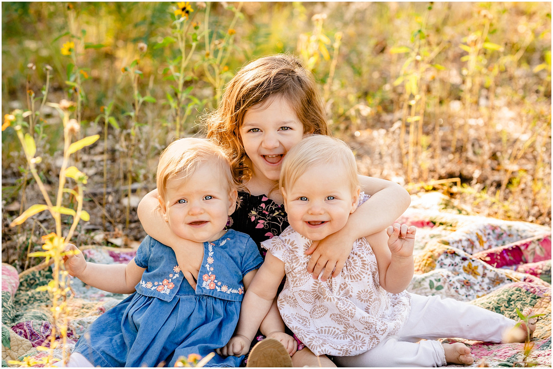 Family with three young girls at McCabe Meadows in Parker, Colorado