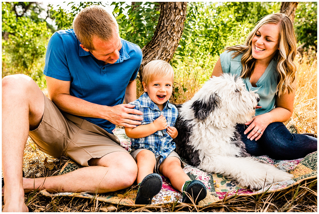 family of 3 with their dog