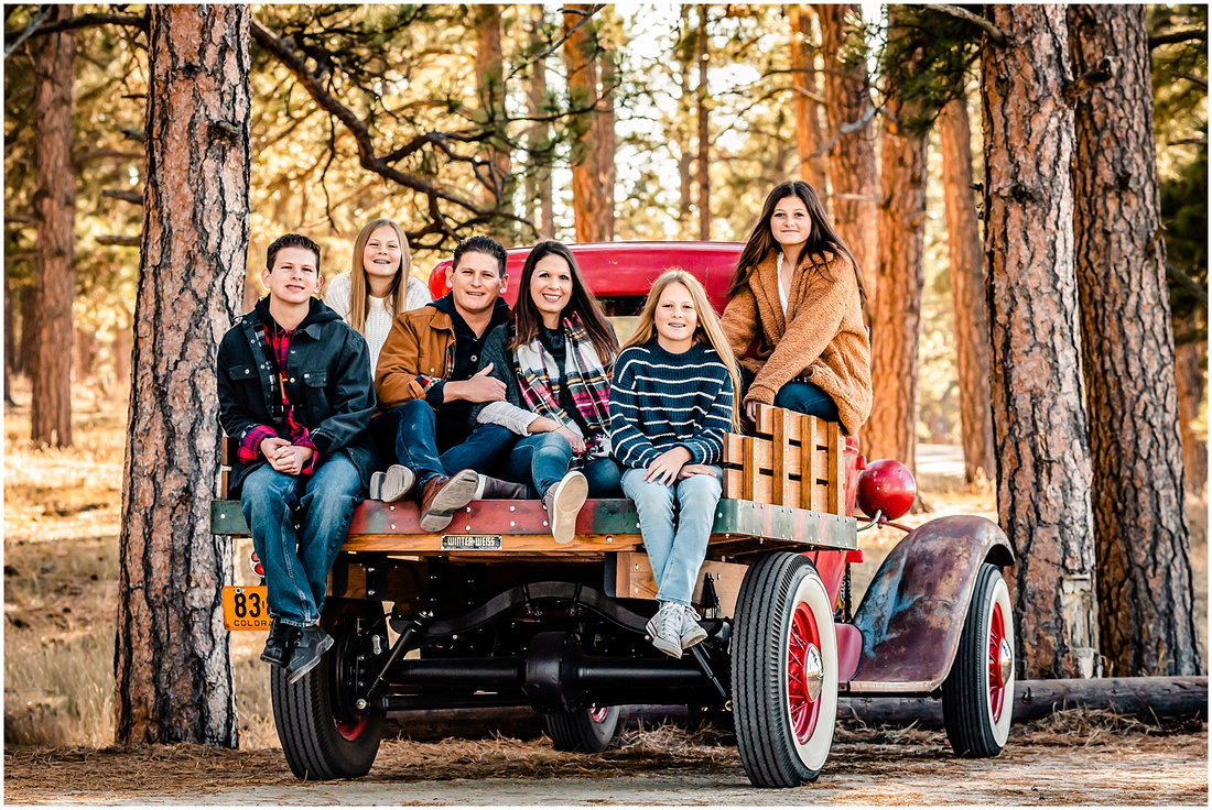 Family of 6 with an antique Ford Model A truck in Colorado